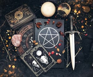 crystals, knife, and tarot cards image