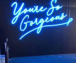 blue neon sign, you're so gorgeous, and queque line posts image