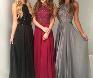black dress, gray dress, and red dress the image