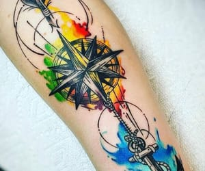 anchor, arm tattoo, and geometric image