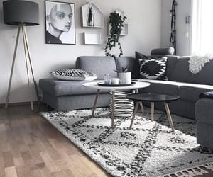 carpet, lamp, and paintings image