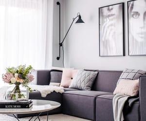 books, sofa, and table image