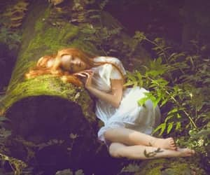 redhead white dress and log forest moss image