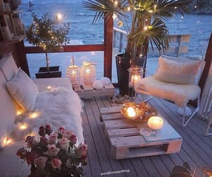balcony, candels, and living room image
