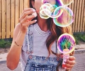 blowing bubbles, girl, and bubbles image