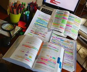 books, desk, and exam image