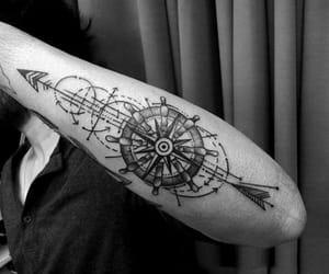 arrow, b&w, and compass image