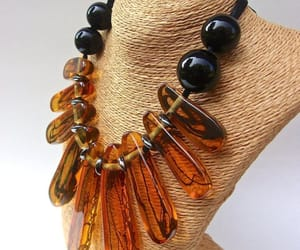 amber, black, and dior image