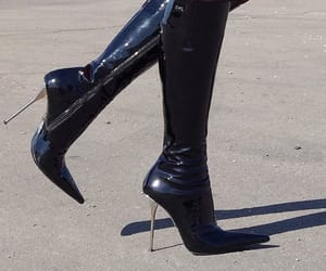 black and heel boots image