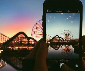 parque de diversiones, telefono, and atardecer image