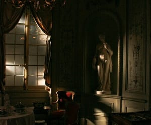 chair, statue, and curtains image