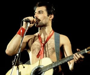 Freddie Mercury, Queen, and guitar image