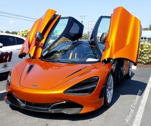 car show, the color orange, and exotics image