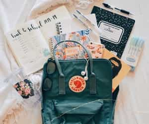 article, backpack, and book image