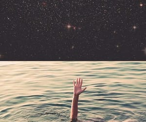 hand, ocean, and sea image