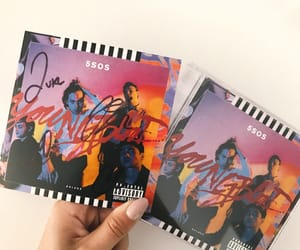 album, cd, and signed image
