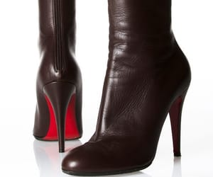 black, red sole, and boots image