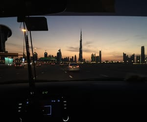 city, car, and sunset image