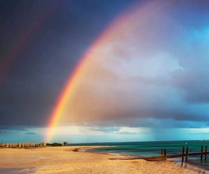 rainbow, beach, and clouds image