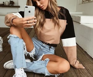 blonde, iphone, and ripped jeans image