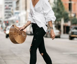 black jeans, white shirt, and high heels image