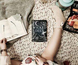books, sweater, and whirlpool image