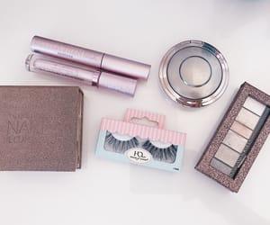 eyeshadow, highlighter, and lipgloss image