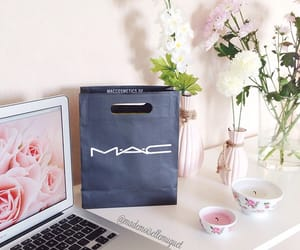 mac, floral candles, and flowers image