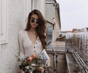 city, flowers, and girl image