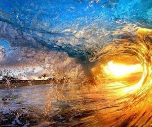 sun, waves, and sea image