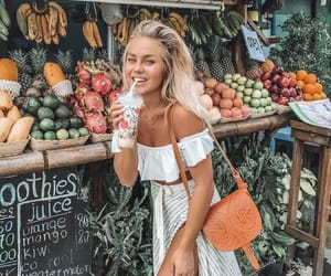 girl, travel, and fruit image