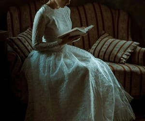 book, white dress, and dim image