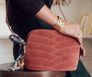 gold bracelet, quilted bag, and floral scarf image