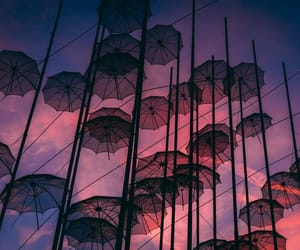 Greece, umbrellas, and pink sky image