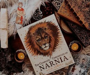 book, candle, and narnia image