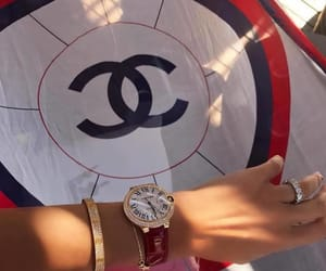 chanel, cartier, and luxury image