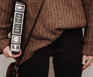 book, sweater, and brown image