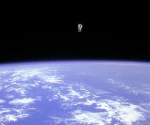 space, earth, and astronaut image