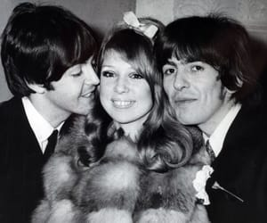 Paul McCartney, george harrison, and pattie boyd image