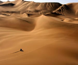 bike, dunes, and desert image