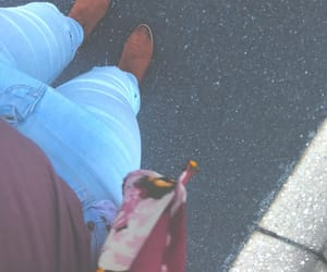 brown boots, jeans, and maybe image