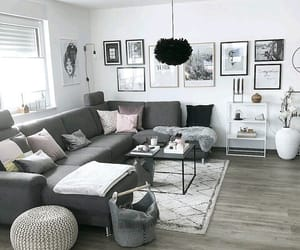 carpet, chandelier, and pouffes image