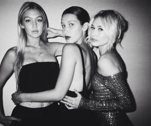 gigi hadid, hailey baldwin, and bella hadid image