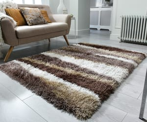 shaggy rugs, brown rugs, and animal print rugs image