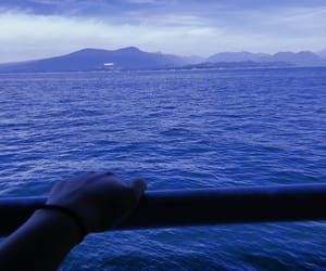 hand, mountain, and sky line image