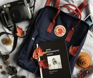 backpack, book, and camera image