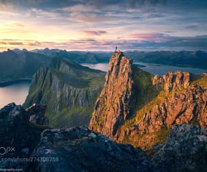 dramatic sky, mountain range, and hill image