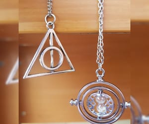 deathly hallows, time turner, and harry potter image