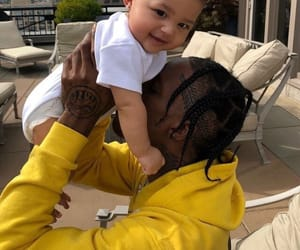 travis scott, baby, and kylie jenner image