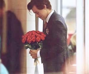 Harry Styles and flowers image